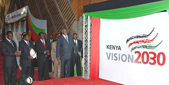 President Mwai Kibaki flanked by Prime Minister Rt. Hon. Raila Odinga, Vice President Hon. Kalonzo Musyoka and Minister for Planning Hon. Wycliffe Oparanya unveils the Vision 2030 Logo after he officially launched the vision and its First Medium Term plan at KICC, Nairobi.